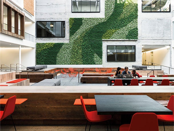 Gensler's 888 Brannan Street project in San Francisco converted the former Eveready Battery Company warehouse into four floors of workspaces. Many offices, including those of Airbnb, open directly to a multistory central atrium with green wall.
