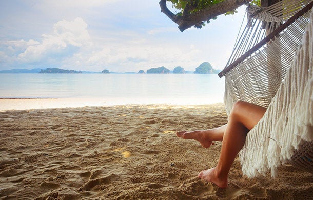 Want a raise? Try taking a vacation - woman on beach