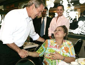 George W. Bush greeting a guest at Miami's Versailles Restaurant.