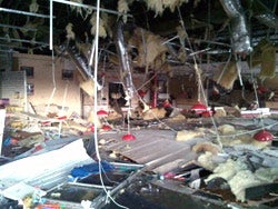 At the Joplin, Mo., Freddy's the roof caved in, windows burst and a wall from a nearby store whipped through the dining room.