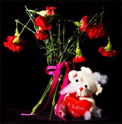 This I love you not bouquet comes with a tattered, unfortunate looking bear holding a heart that says I love you.