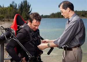 Ready for takeoff: JetLev creator Raymond Li straps in instructor Larry Katz.