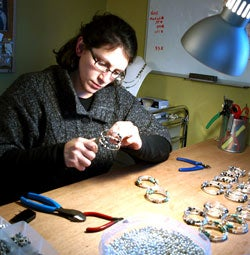 Kristine Lewis, the owner aof Crazyartgrrl Jewelry, making bracelets.
