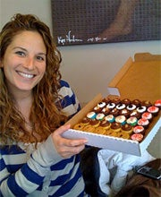 Melissa Bushell of Baked by Melissa with some of her mini cupcakes.