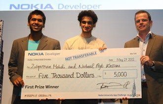 Nabeel Ayub Kassim (center) won top prize in Nokia'sapp challenge by creating BonAppetit