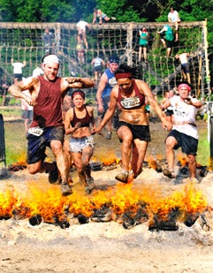Extreme Heat: Warrior dash contestants run through flames, mud and other obstacles.