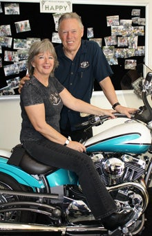 Kathy and Rodney Tolleson, sitting in the shop and on a WildKaT