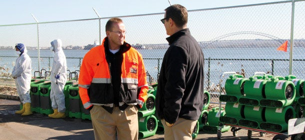 Answering the call: Servpro franchisee Randy Miller (left) and executive vice president Rick Isaacson in Elizabeth, N.J., during the Hurricane Sandy recovery effort.