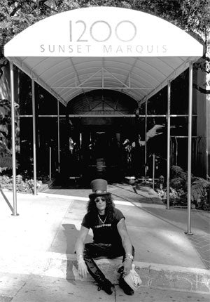 Curb appeal: Guns N' Roses guitarist Slash at the hotel's unassuming entrance.