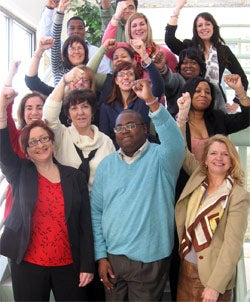 Employees of the Wisconsin Women's Business Initiative Corporation wearing their Create Jobs for USA wristbands.