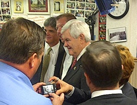 Newt Gingrich, speaking with reporters at Tommy's Ham House in Greenville, S.C.