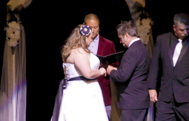 Zappos employee Heather Wetsel got married at the company's all-hands meeting. Tony Hsieh served as the wedding's officiator.