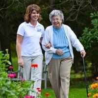 Visiting Angels franchise worker assisting senior citizen