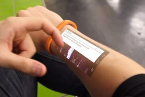 A Simple Bracelet Can Turn Your Arm Into an Interactive Smartphone Display