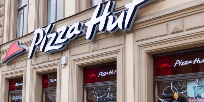 Pizza Hut's Second-Largest Franchisee Sued in Pay Dispute