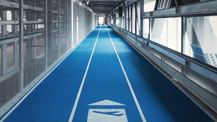 Ever Sprint to Catch a Flight? You'll Appreciate This Airport's Racetrack Lanes.