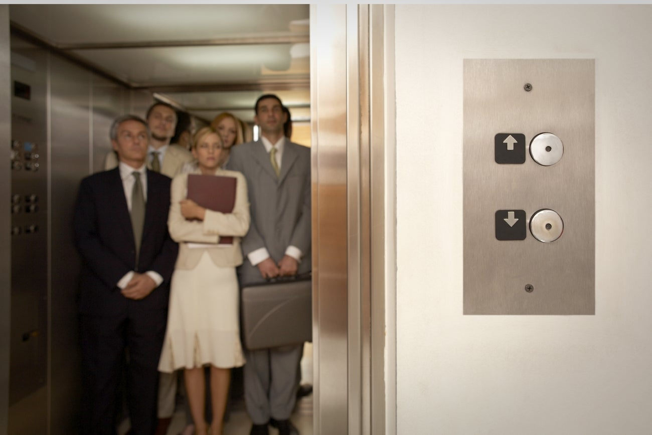 people talking in elevator. 7 essentials for an elevator pitch that gets people to listen talking in