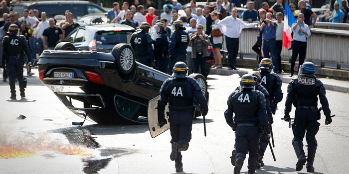 Chaos Unfolds in France as Uber and Taxi Drivers Riot