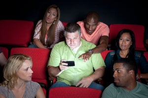 Does Allowing Texting at Movie Theaters Bring People In, or Drive Them Away?