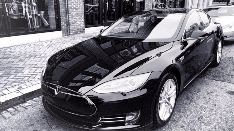 Tesla and Its Rivals Joust Over How to Put Self-Driving Cars on the Road