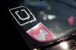 Uber, Lyft Set to Defend Driver Settlements in Court