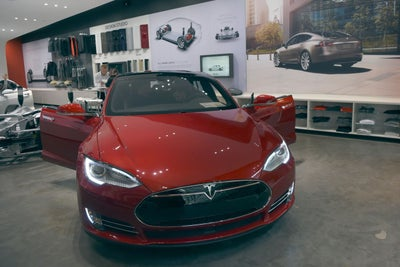 You Can Watch Elon Musk Hand Over the First Affordable Teslas Live Ton...