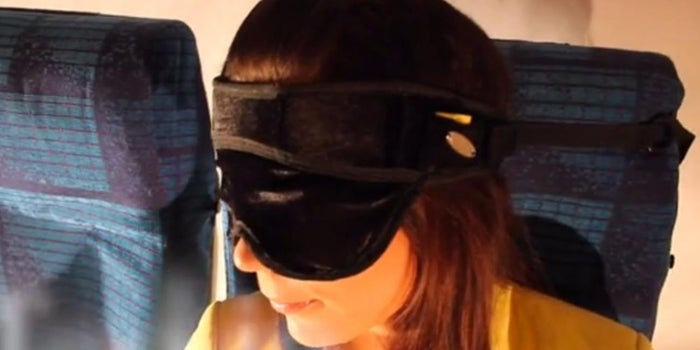 This Crazy Contraption Straps Your Head to an Airline Seat for Better Sleep