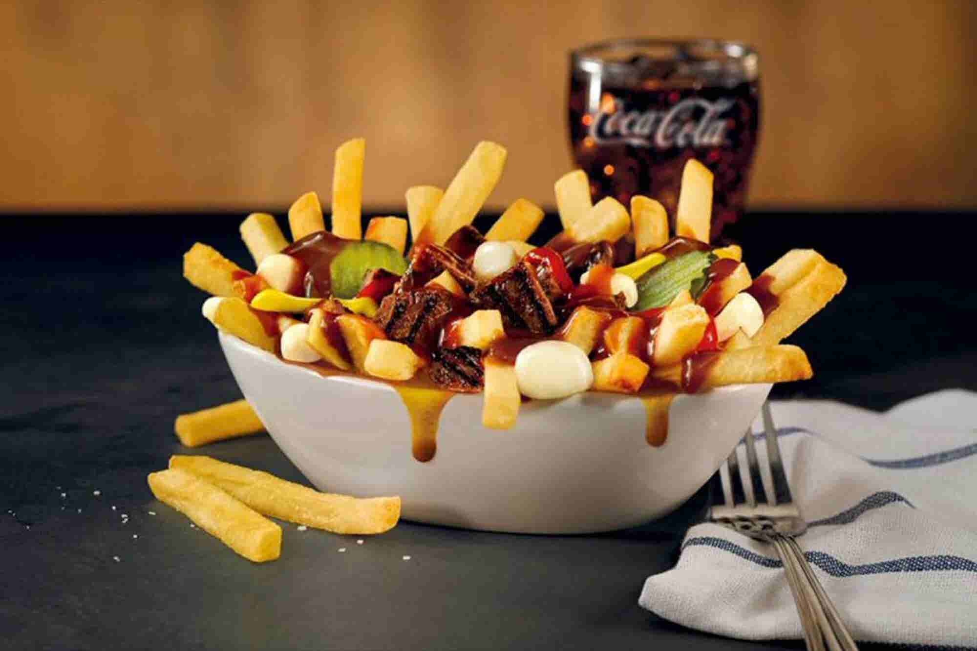 Burger King Launches the Ultimate Canadian Mashup: Poutine Topped With a Whopper