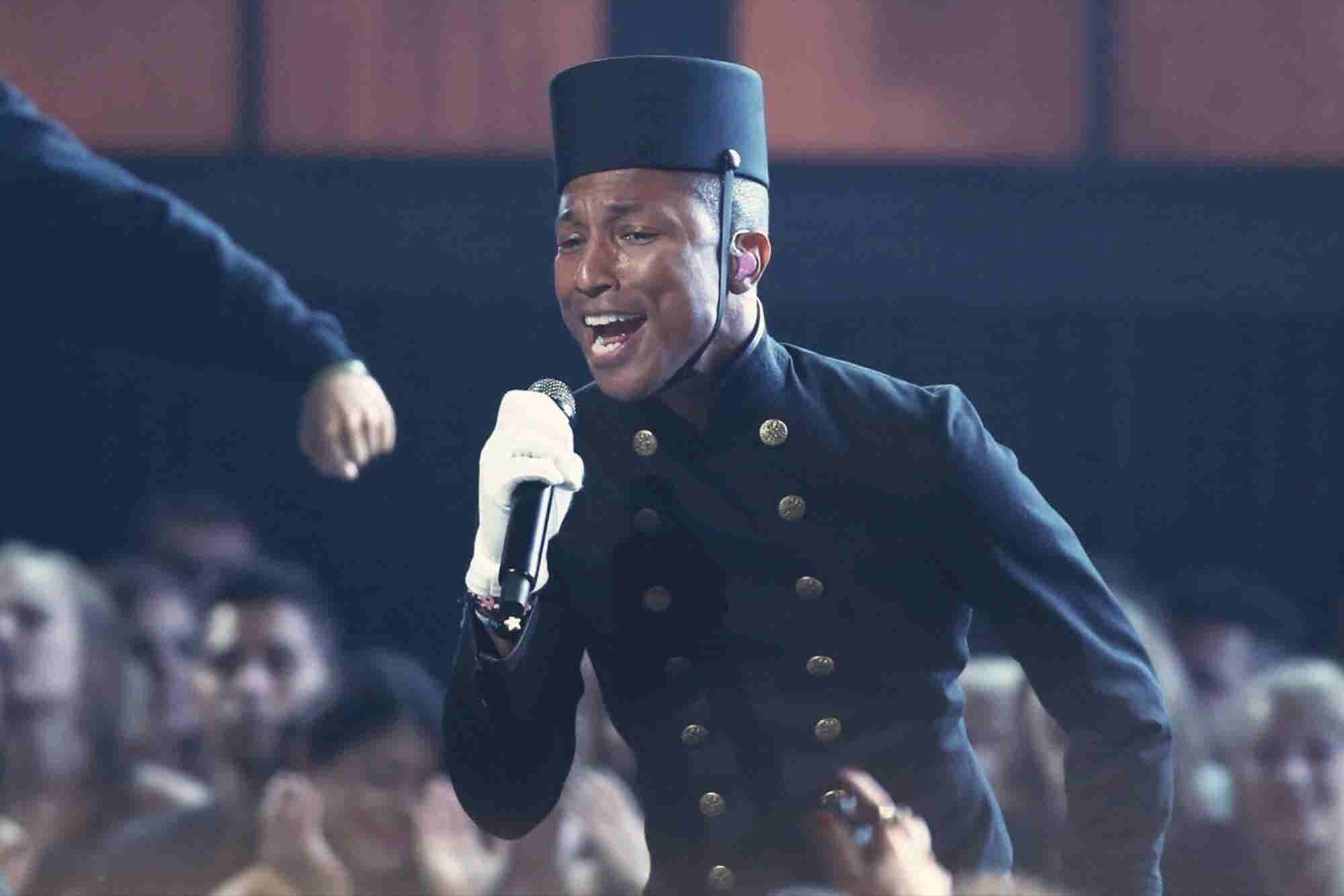 Pharrell Dresses as Hilton Bellhop, Becomes a Brand Favorite Yet Again