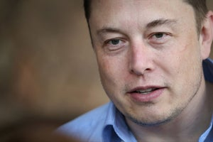 Forget Solar Panels -- Elon Musk Wants to Build Solar Roofs