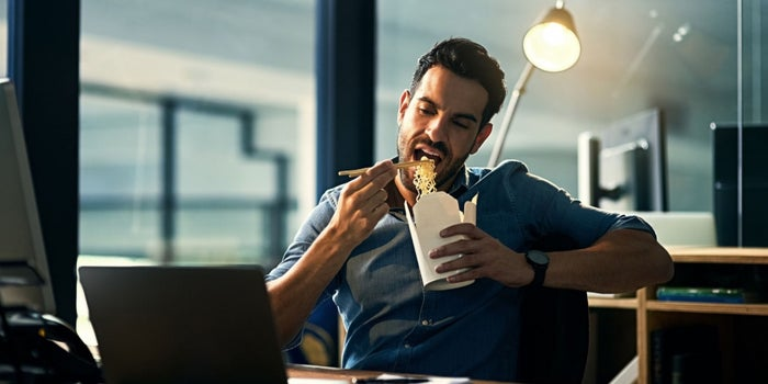 Ask the Etiquette Expert: How to Eat at Your Desk Without Offending Others