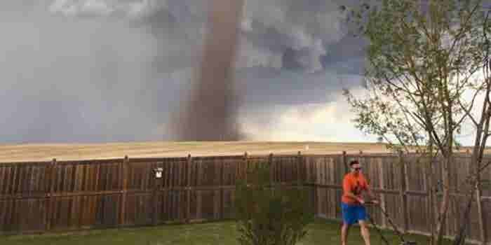 The Canadian Man Mowing His Lawn Amid a Tornado Is a Role Model for Us All