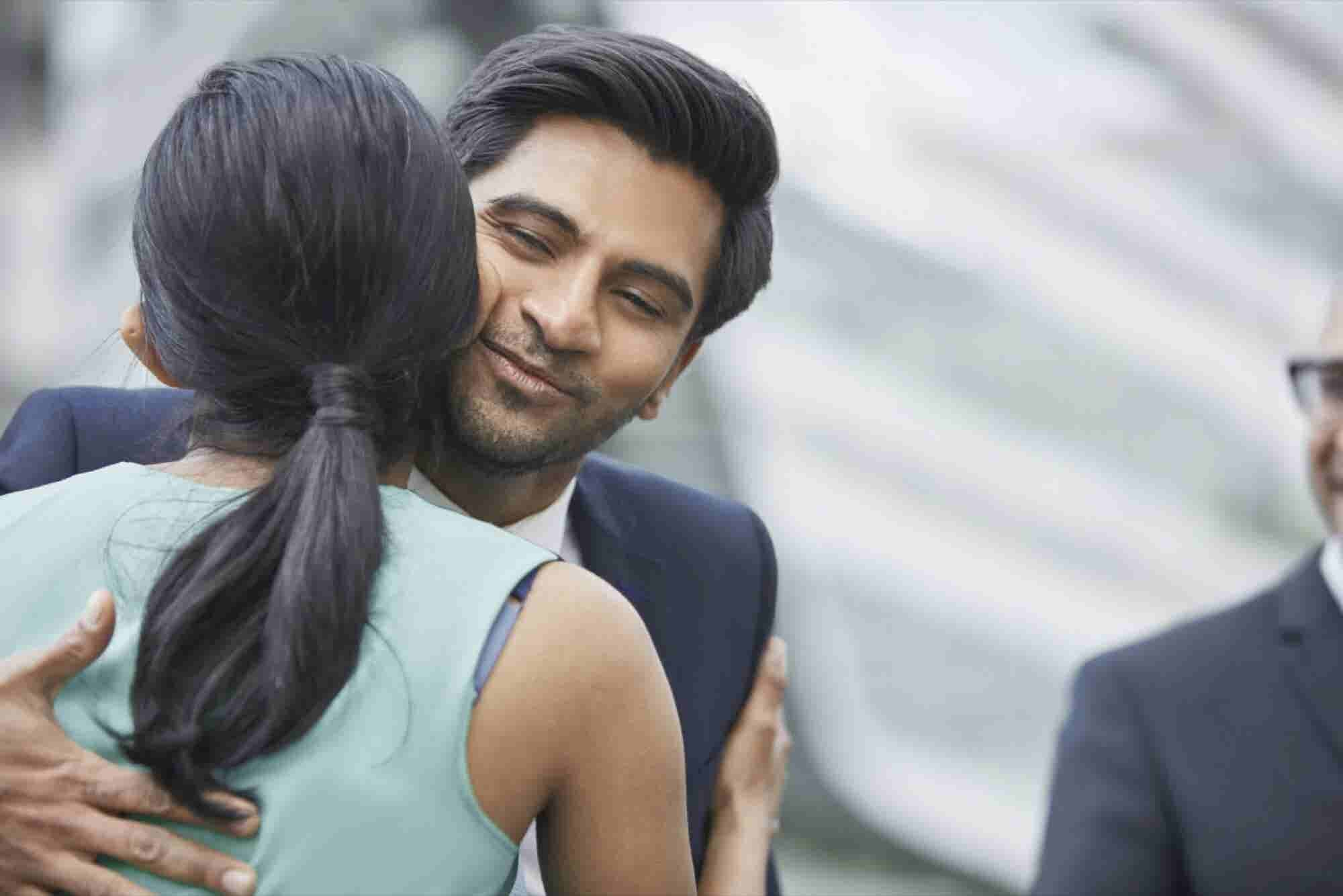 Ask the Etiquette Expert: How to Handle a Hugger