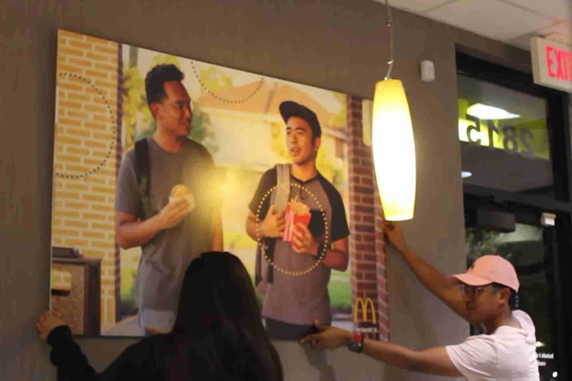 These Friends Snuck a Poster of Themselves Into Their Local McDonald's -- and It's Still There