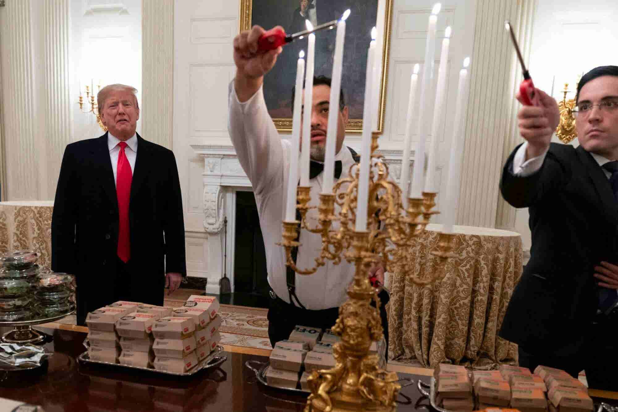 Trump Greets Clemson Tigers With Fast-Food Buffet of Wendy's, McDonald's and Burger King as They Celebrate Their National Championship