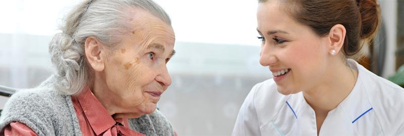 Acti-Kare - Caregiver and senior talking