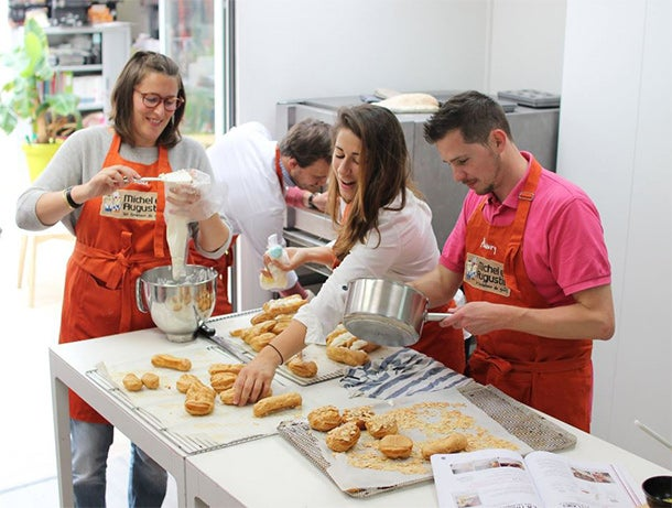Paris HQ is tasty: Staffers prep vanilla ?clairs days before their mandated pastry exam.