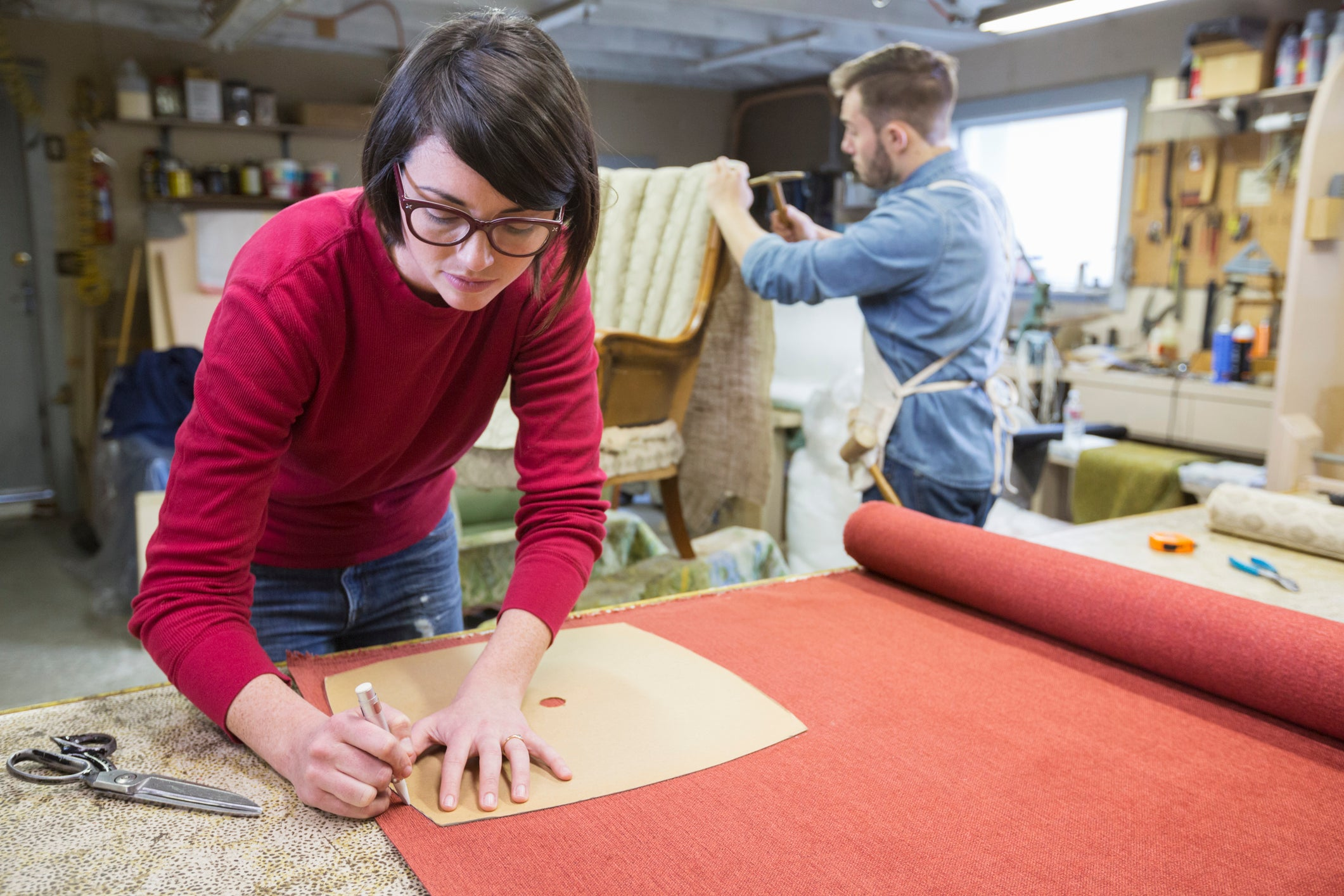 business owners reupholstering furniture