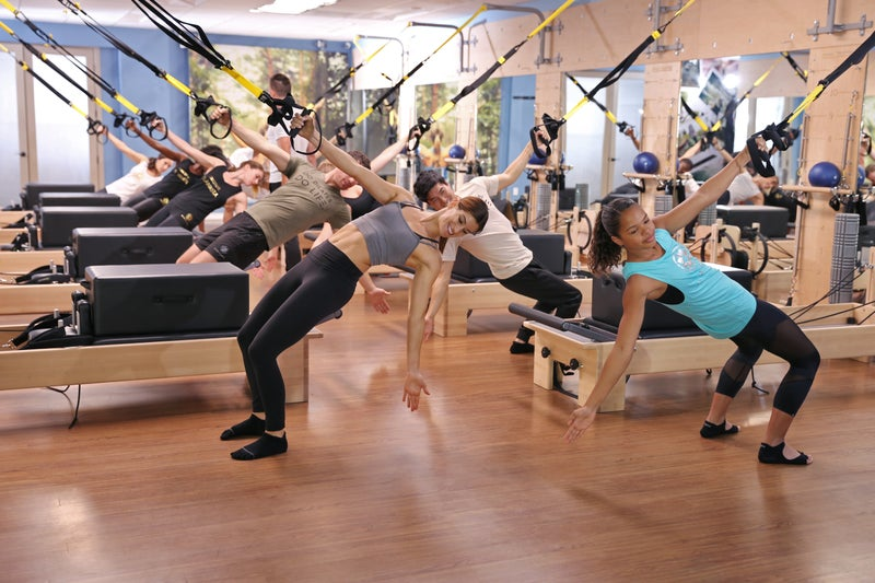 Two women working out at Club Pilates Gym