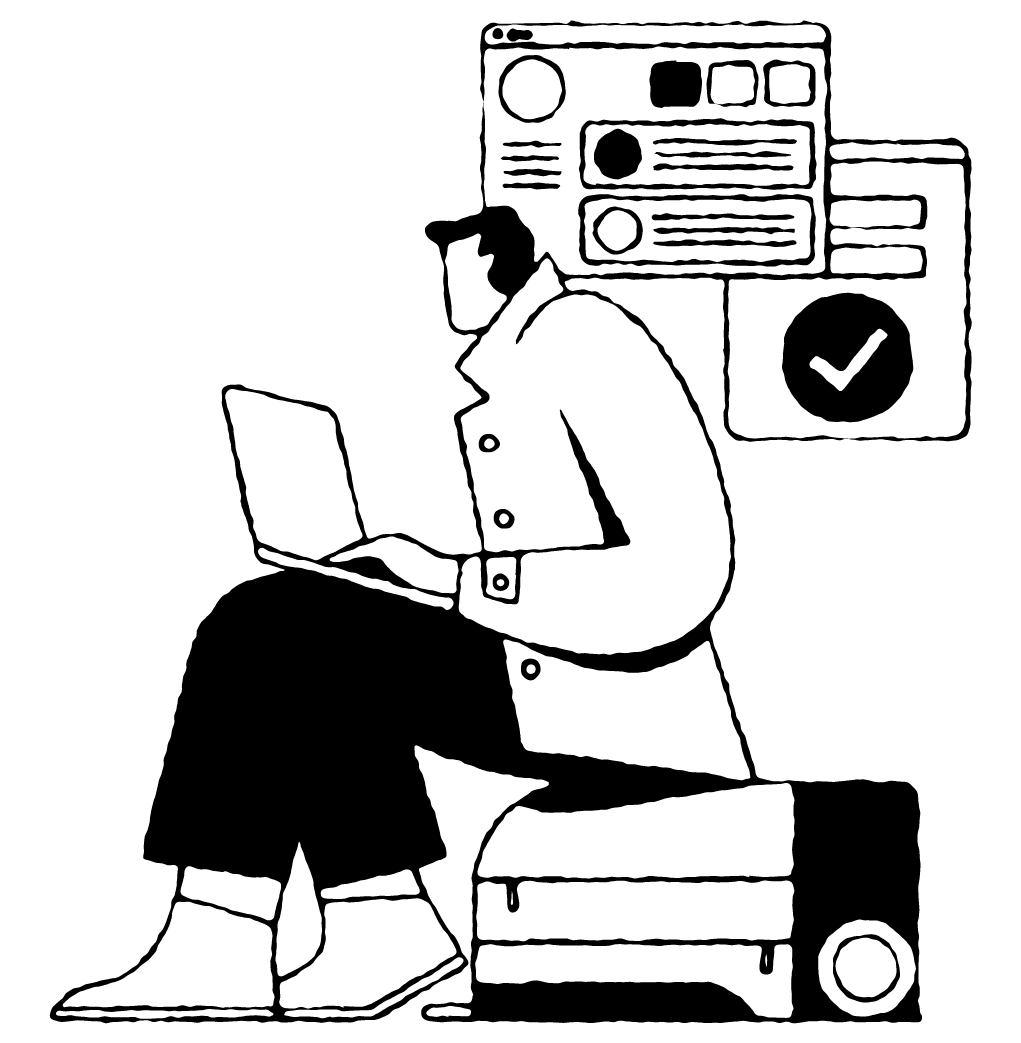 Person sitting on luggage and typing on their laptop