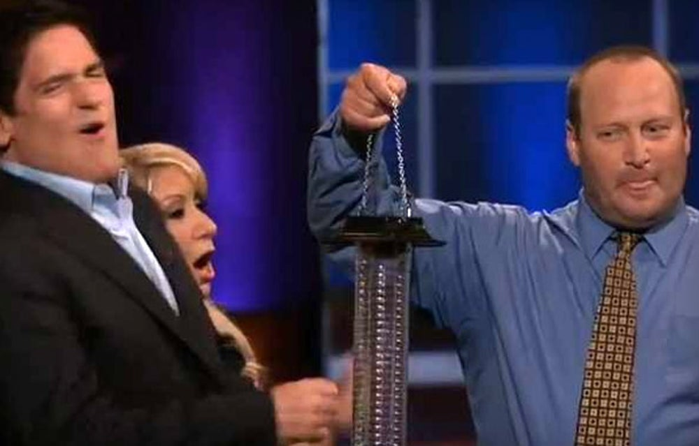 Desanti demonstrates his invention by shocking Mark Cuban.