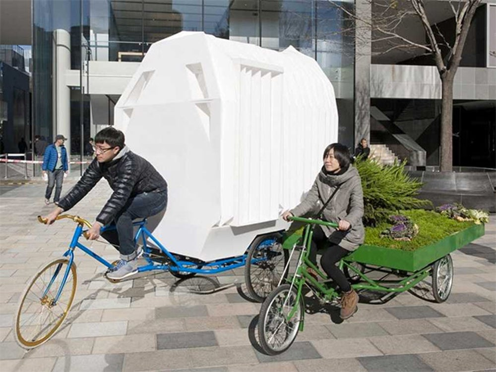 This small home in China is built on top of a tricycle.
