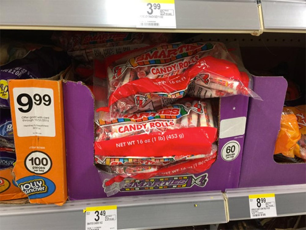 I went to Walgreens and bought a pack of Smarties, my favorite Halloween candy.