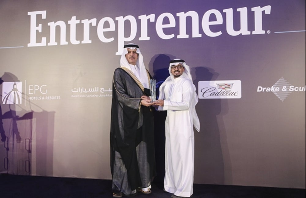 Abdul Samad Al Qurashi & Sons accepting the Retail Innovation award with Riyadh Chamber of Commerce and Industry, Vice Chairman of the board of directors, Mr. Khalid Abdulaziz S. Al-Mukairan