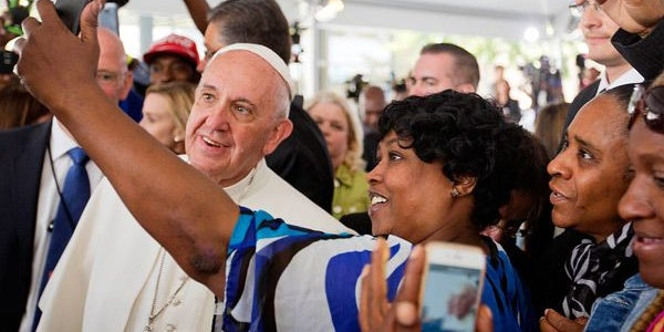 Posing with the pope