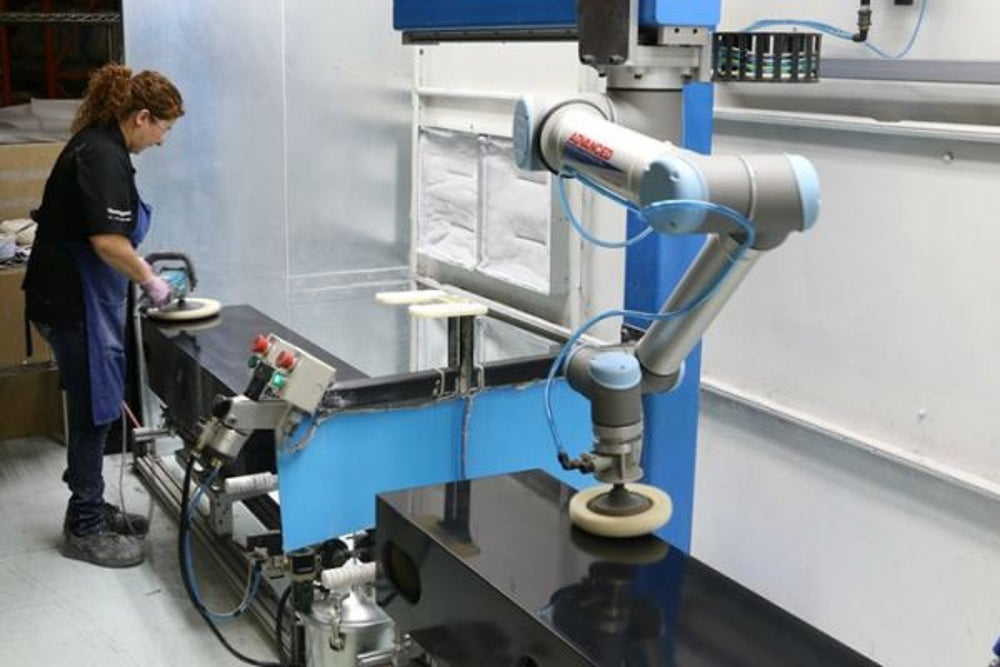 Universal Robots collaborative robots work alongside manual laborers, increasing their efficiency.