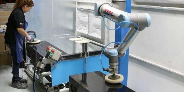Universal Robots collaborative robots work alongside manual laborers, increasing their efficiency.