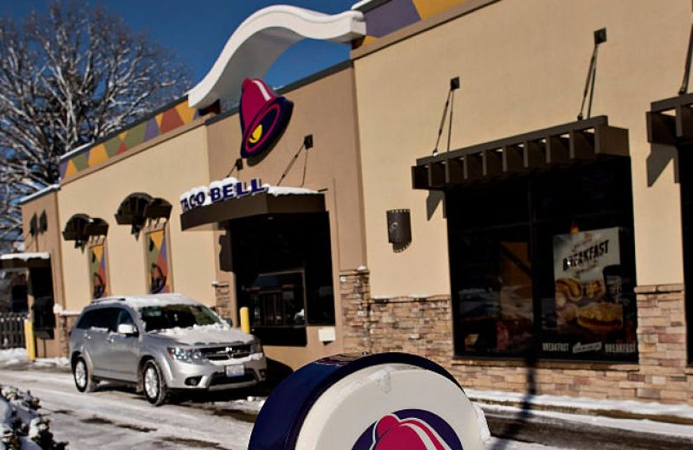 An angry college basketball star got stuck in a Taco Bell drive thru window.