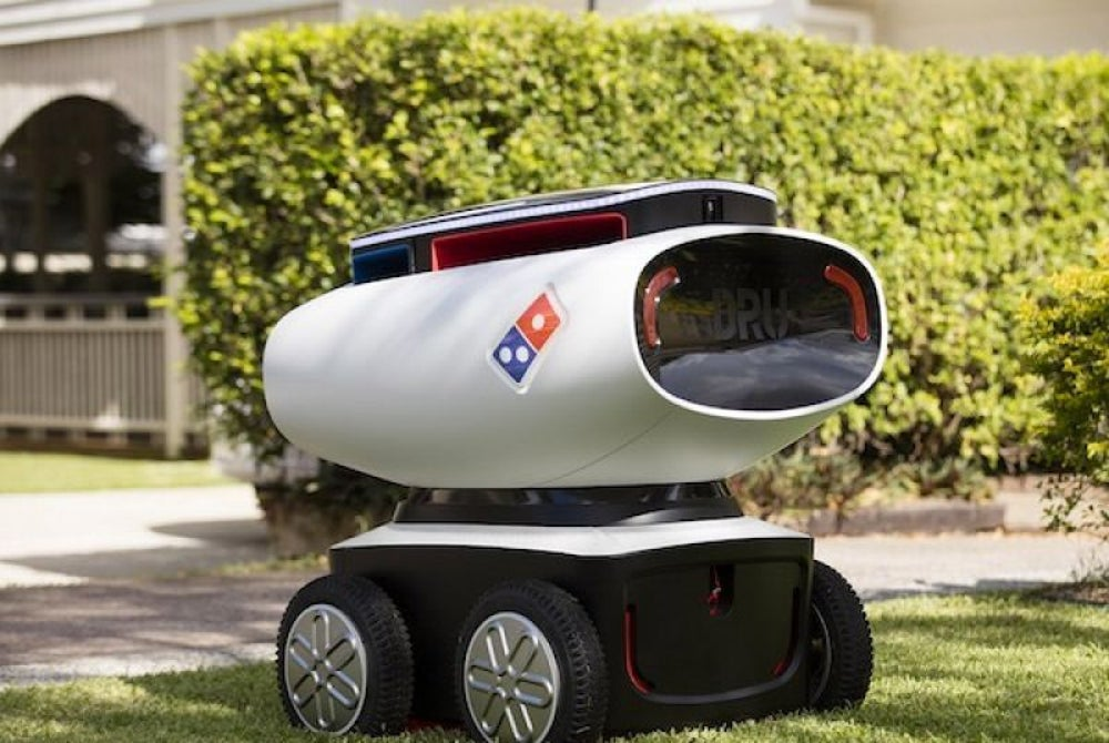 Robots are delivering pizzas to Domino's customers.