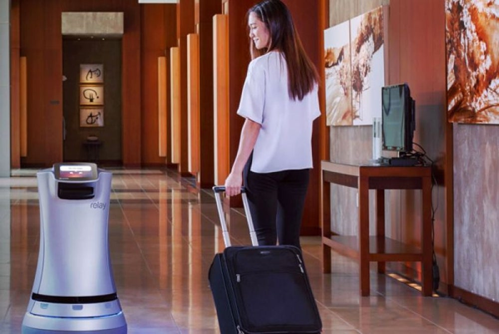 Crowne Plaza uses a robot to deliver room service.